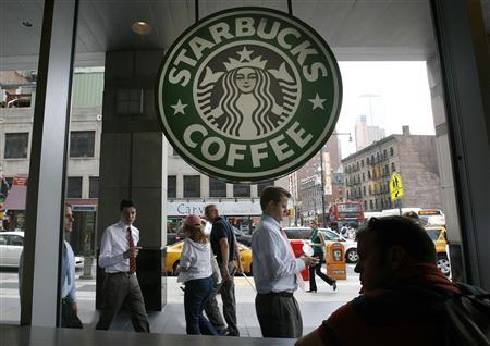 File photo of people walking past the Starbucks outlet on 47th and 8th Avenue in New York.